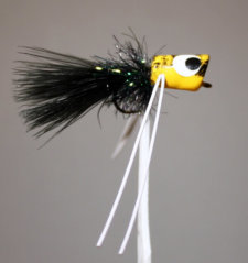 River Runt yellow body, black hackle, black tail, white rubber legs