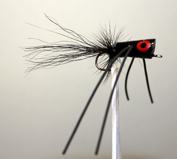 Willow Bug in all black, black body, black hackle, black tail and black rubber legs
