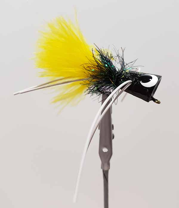 River Runt from Brank N Brine, black body, black hackle, yellow tail and white rubber legs